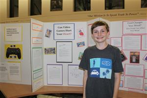 7th grade science student with project