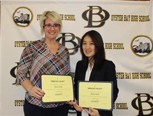 Janet Link and Maria Kim with Bright Lights certificates