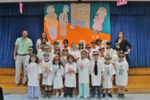 "Mr. Agostini's class pose after performing a readers' theater on the book ""Flat Stanley"""