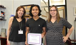 National Merit winner with principal and school counselor