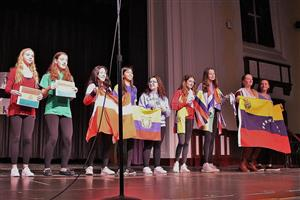Spanish students sing with flags at International Night