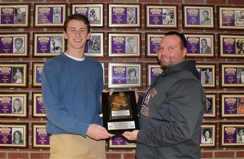 sean and coach with award