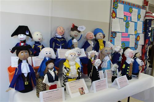 students created historical figures out of plastic bottles and art supplies