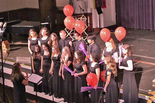 chamber singers with balloons