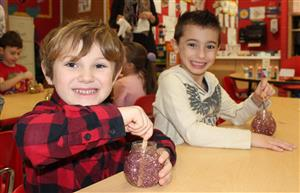"Roosevelt kindergartners create ""Mind Jars"" with water, glitter and jars."