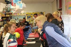 Visitors tour the third grade wax museum at Vernon