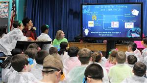 second graders watch a video as an introduction to Science Fun Night