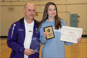 Coach with 300th win plque and Rachel with Nassau champ plaque for fencing