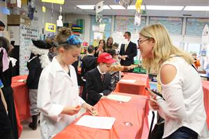 families listen to third graders present their biographies during the interactive wax museum presentation