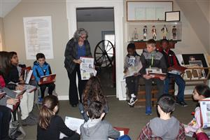 Vernon students learn about northern slavery. Tour guide references ads for slaves