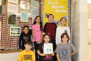 students display book selection for Read-In