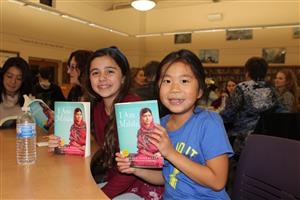 students speak at community book club