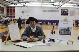 a Raynham Hall educator is dressed in colonial clothes