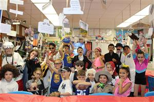 Ms. Flatley's class dressed in costume for the wax museum